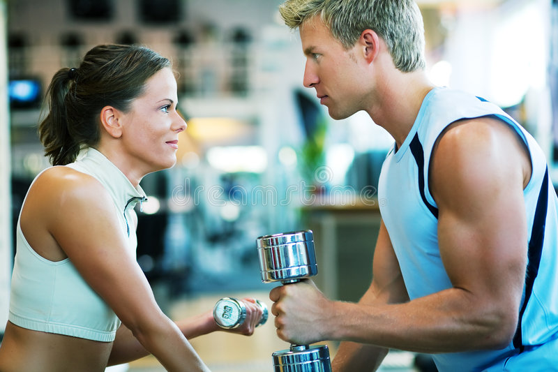Couple working out. A couple exercising, looking at each other royalty free stock image