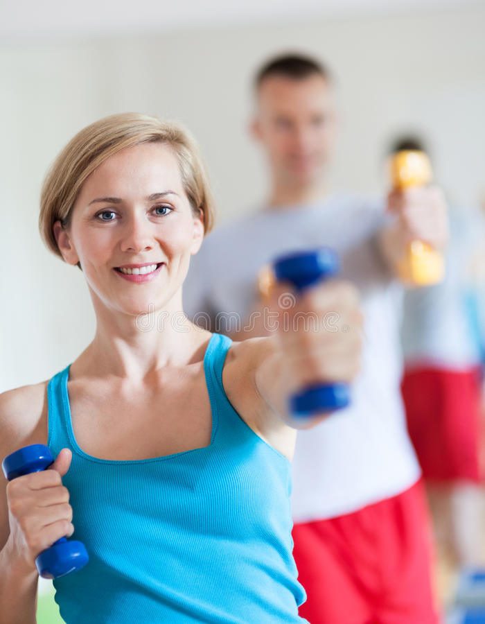 Couple working out with dumbbells stock photos
