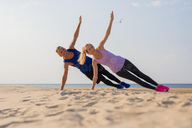 Couple working out by the sea stock image