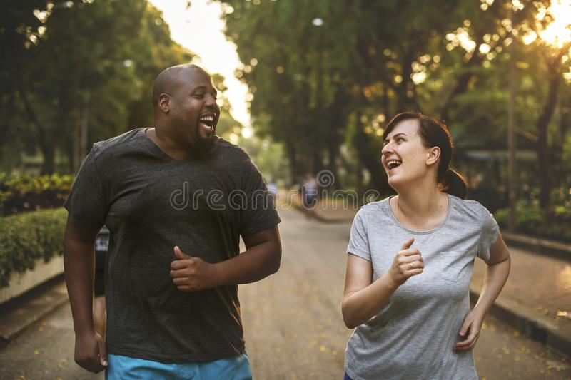 Couple working out together in evening stock photography