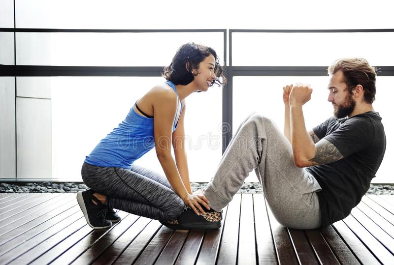 Couple working out together. Fitness royalty free stock photography