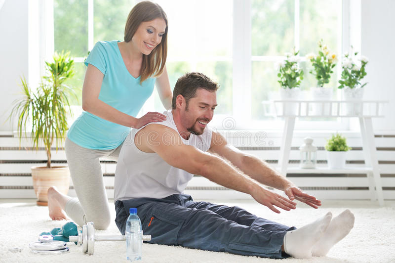 Couple working out together at home stock photos