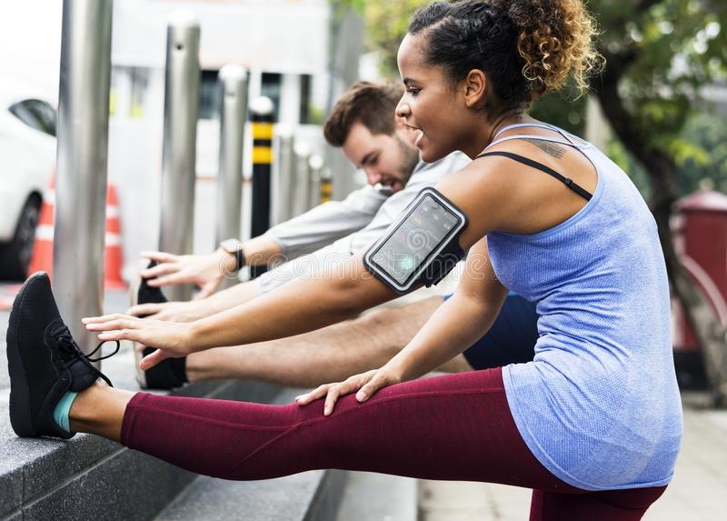 Couple working out together outdoor royalty free stock photography