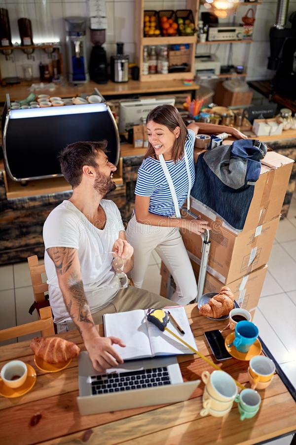 Couple working and ready to open their cafe stock images