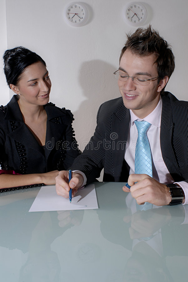 Couple working at table stock photo
