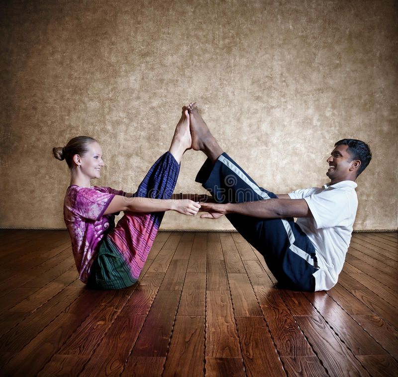 Couple yoga of man and woman royalty free stock photo
