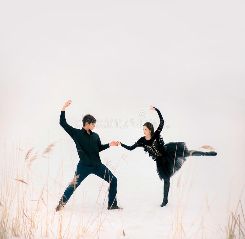 Couple of young ballet dancers perform outdoor in stock image