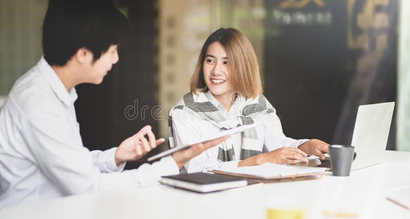 Couple of young businesspeople discussing new idea stock image