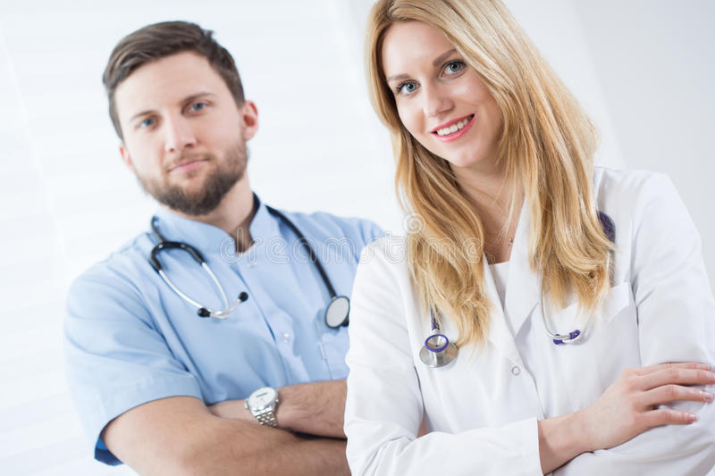 Couple of young doctors royalty free stock photos