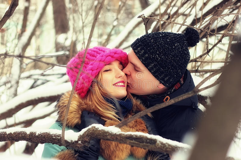Couple of young lovers winter stock photography
