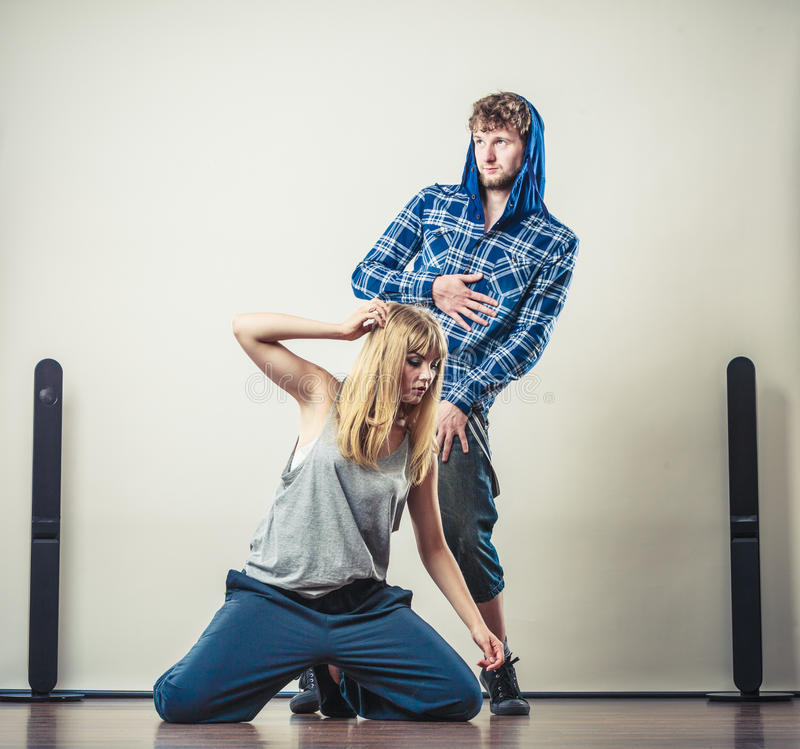 Couple of young man and woman dancing hip-hop royalty free stock photos