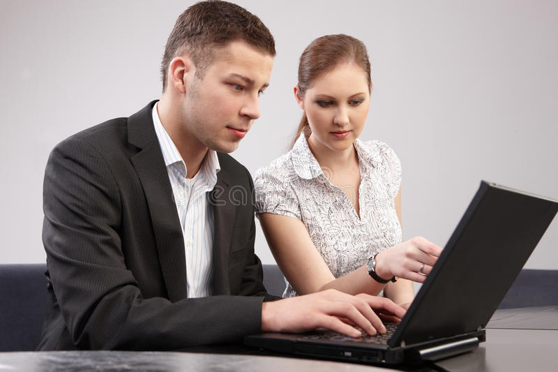 Couple of young people in the office working toget royalty free stock images