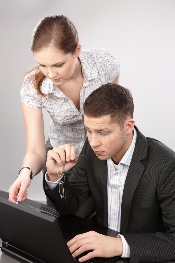 Couple of young people in the office working toget stock images