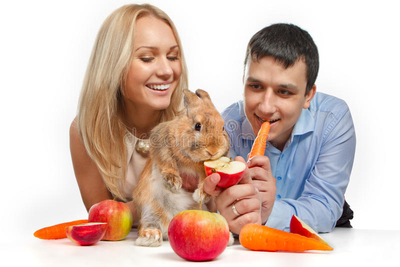 Couple With Young Rabbit Stock Image