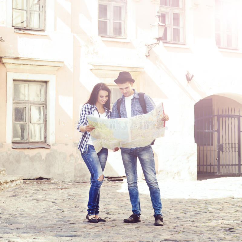 Couple of young travelers with map royalty free stock photo