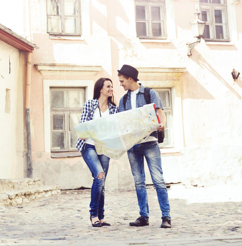 Couple of young travelers with a map royalty free stock photos