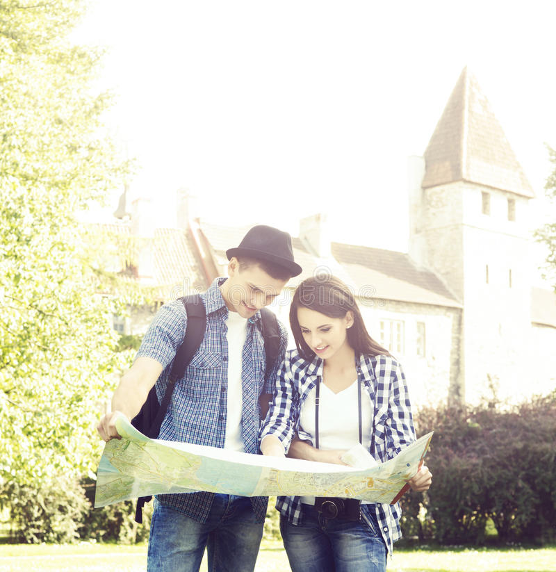 Couple of young travelers with a map stock photo