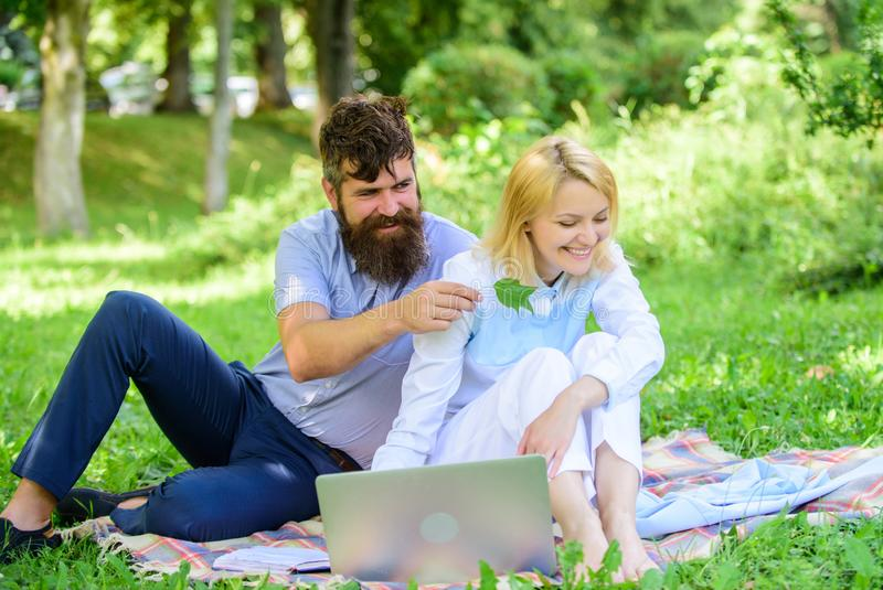 Couple youth spend leisure outdoors working with laptop. How to balance freelance and family life. Couple in love or. Family work freelance. Freelance life royalty free stock photos
