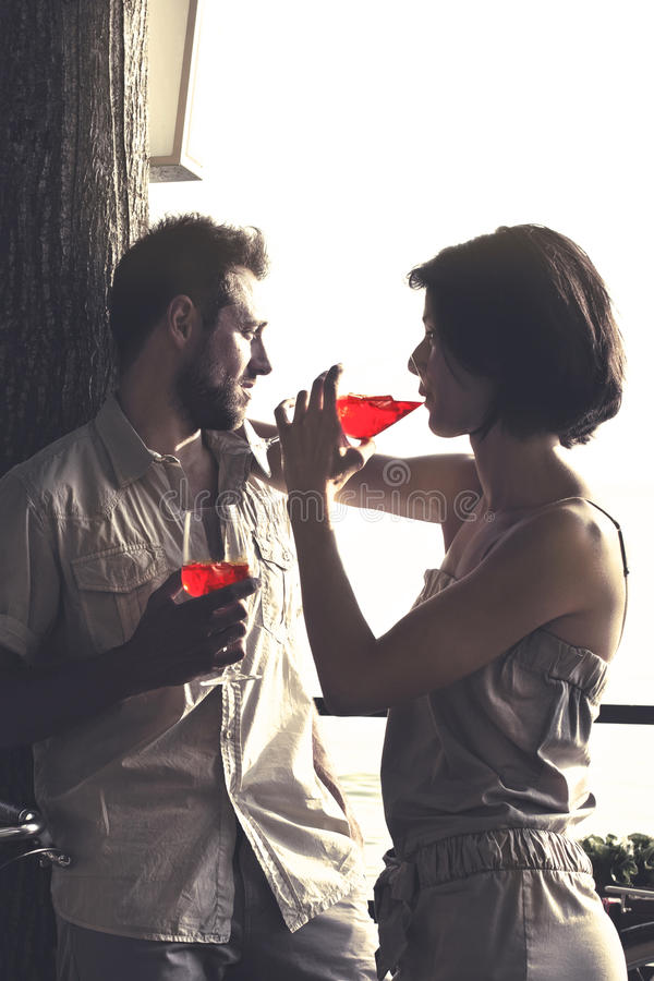 Couplein love having spritz time in a terrace royalty free stock image