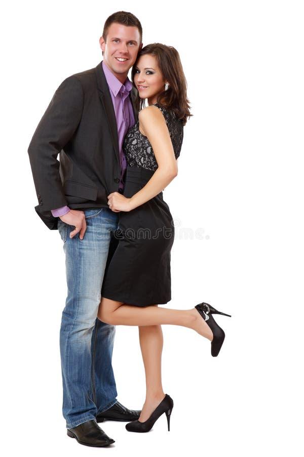 Couples élégants heureux dans le studio photo libre de droits