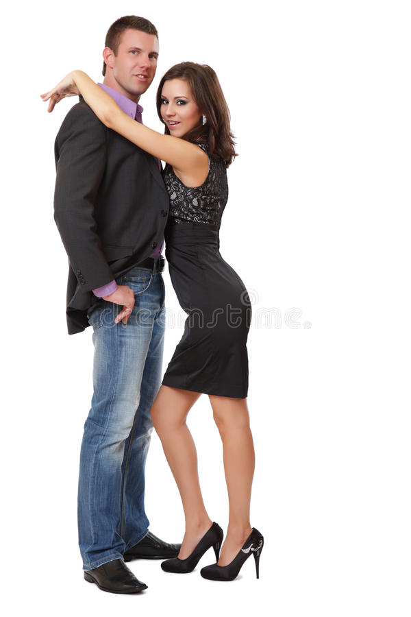 Couples élégants heureux posant dans le studio photographie stock libre de droits