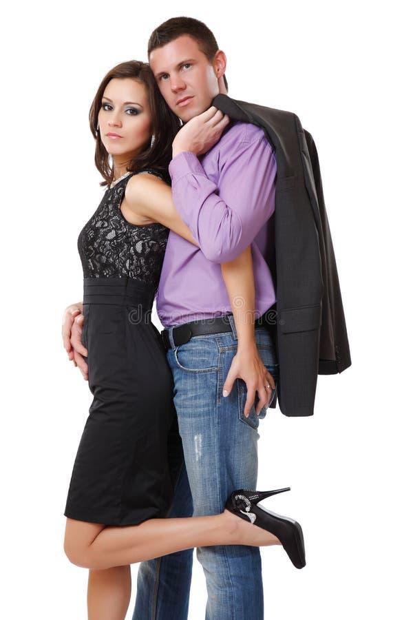 Couples élégants sexy posant dans le studio photos stock