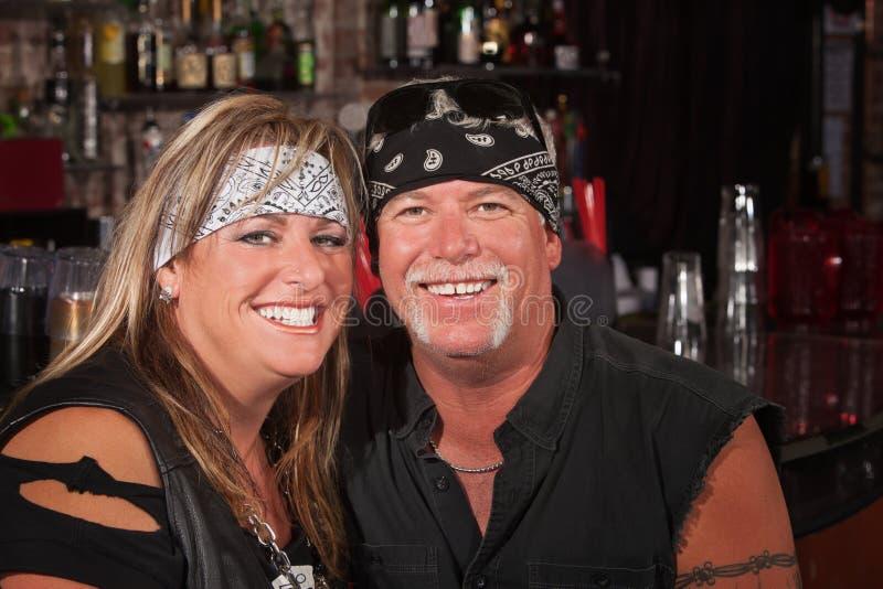 Couples adorables de curseur de moto images libres de droits