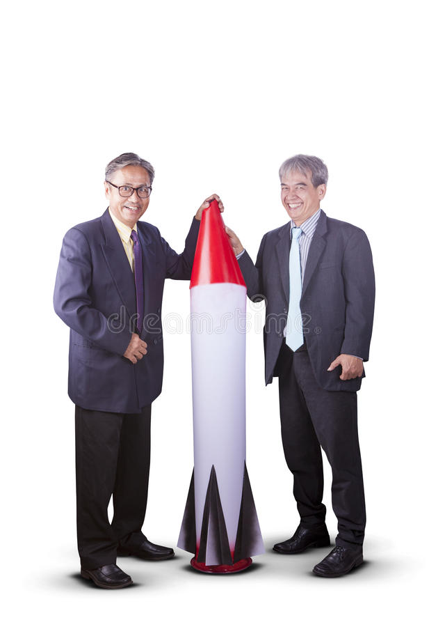 couples of asian business man with rocket missile ,conceptual for business strategy target royalty free stock photography
