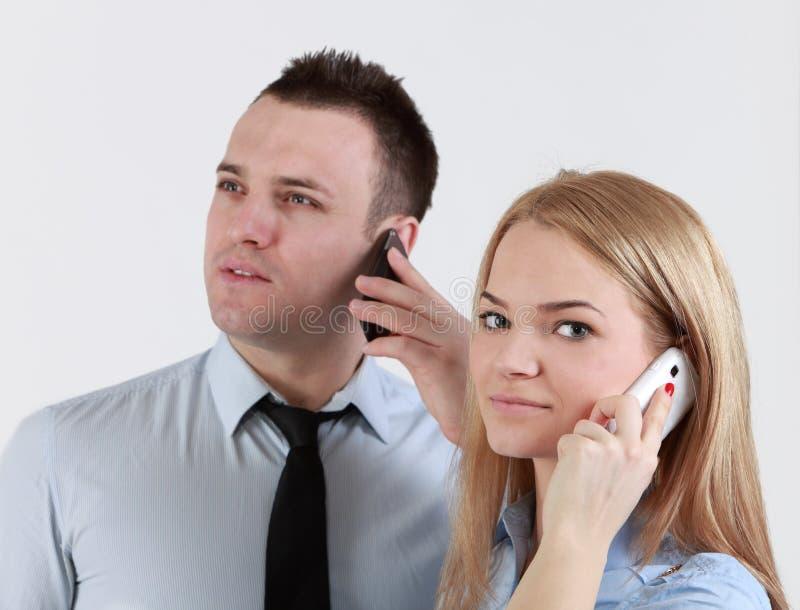 Couples au téléphone image libre de droits