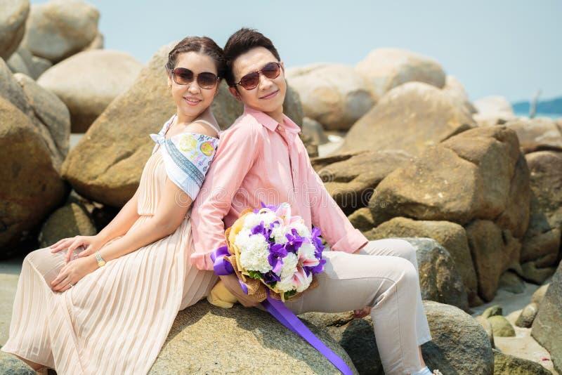 Couples at beach stock photos