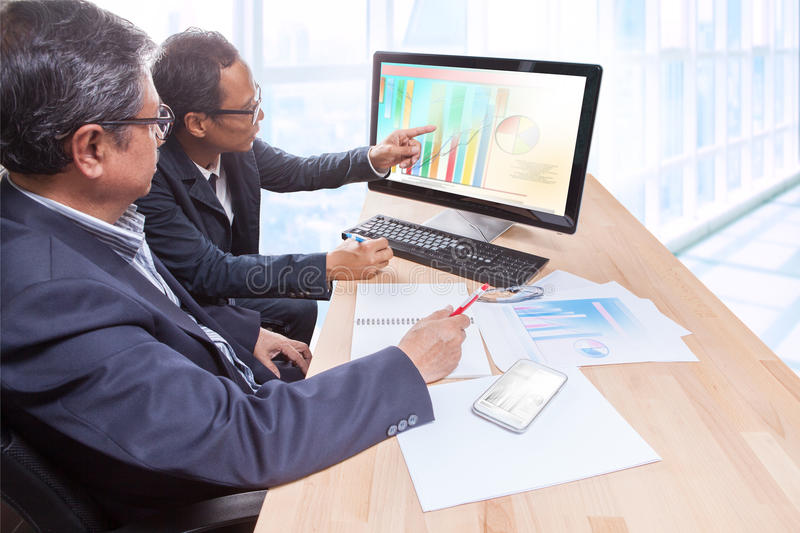 couples of business man team meeting strategy analysis for planing to successful in leadership stock photo