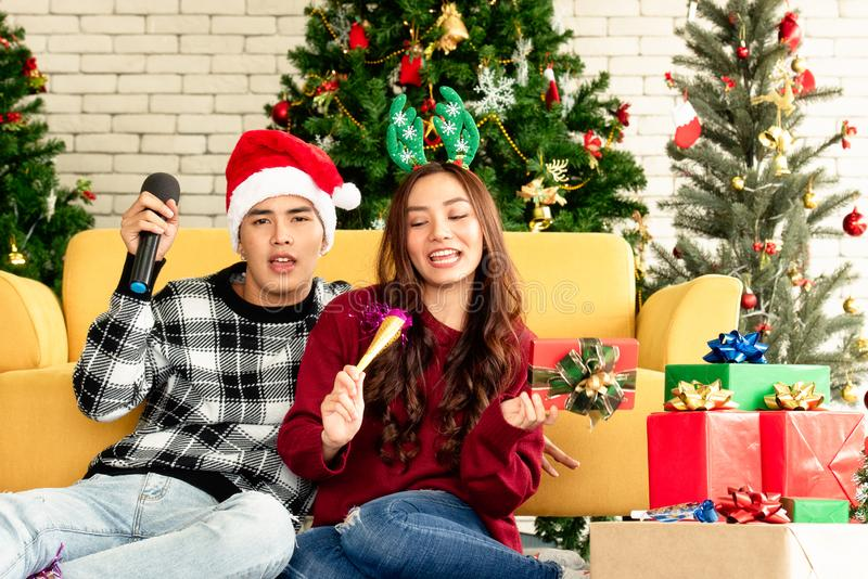 Couples celebrating Christmas decorating in home royalty free stock images