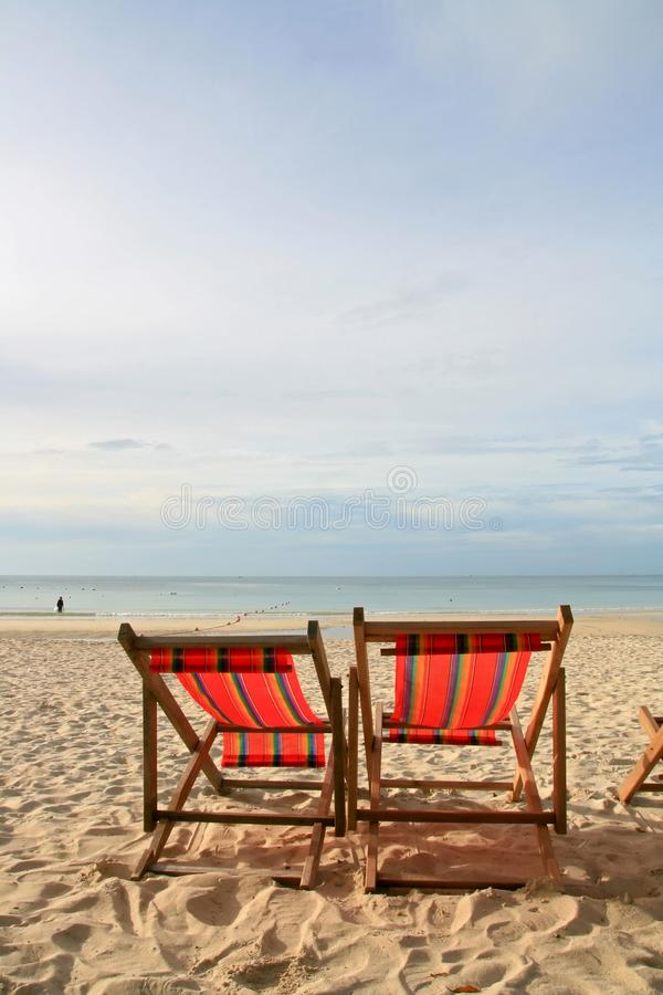 Couples chairs beach on the beach royalty free stock photography