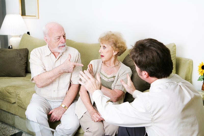Couples Counseling with Copyspace. Senior couple arguing in a counseling session. Copyspace for text stock images