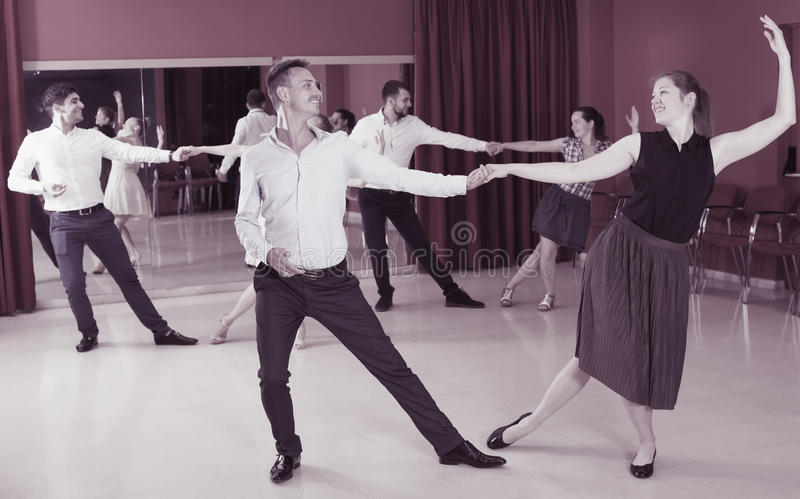 Couples dancing boogie-woogie royalty free stock photos