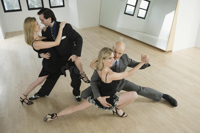 Couples dancing tango royalty free stock images