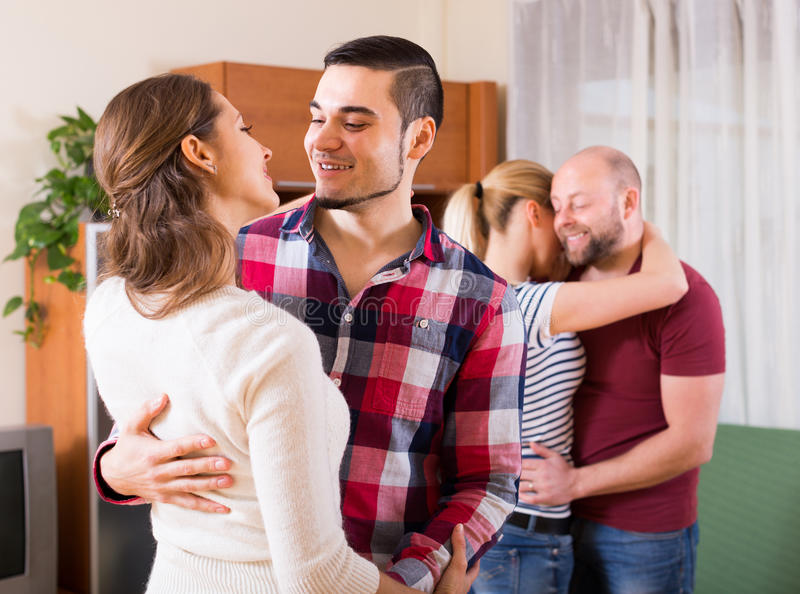 Couples dancing together. Romantic couples dancing together at home party royalty free stock images