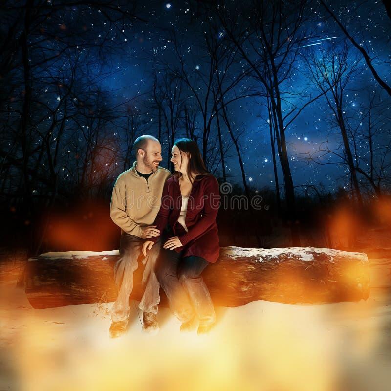 Couples dans la neige photographie stock libre de droits