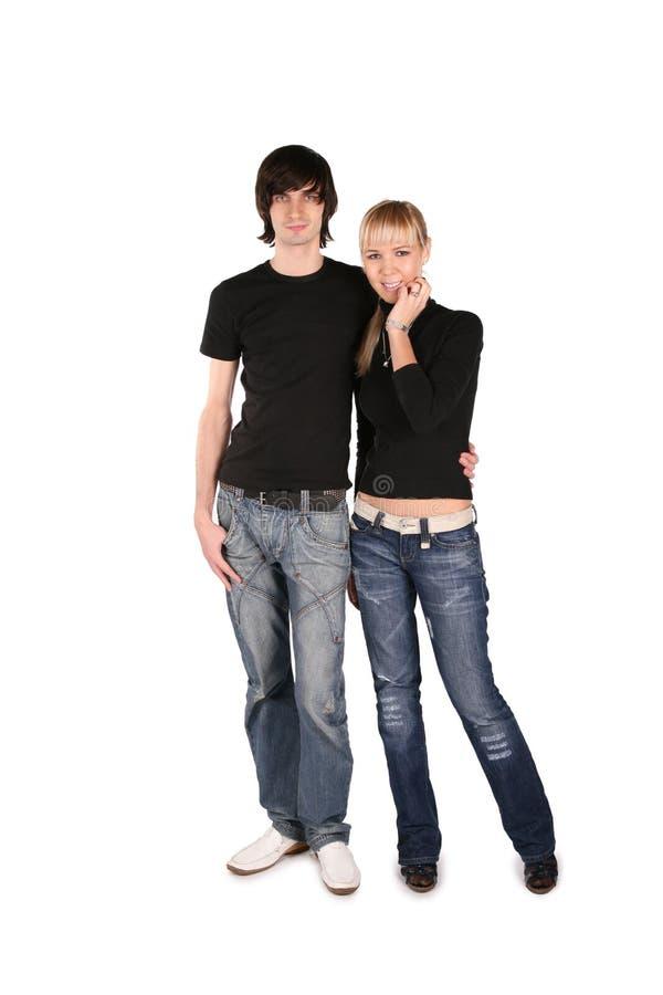 Couples dans les stands noirs photographie stock