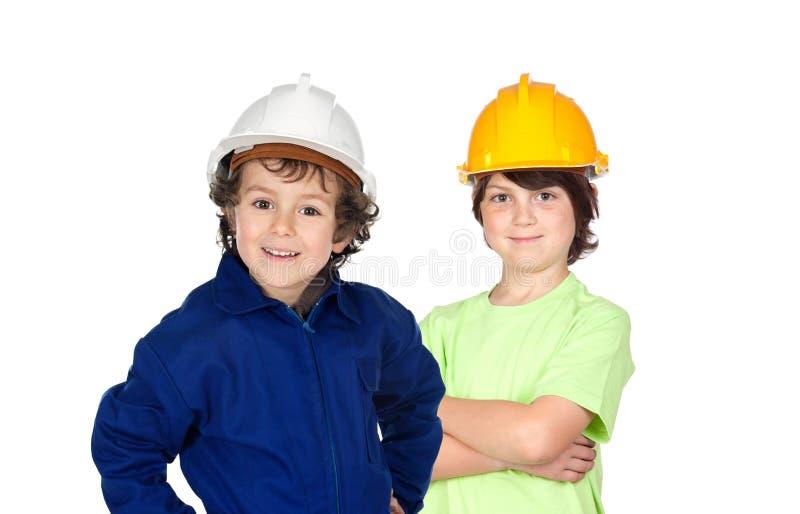 Couples de deux jeunes travailleurs de la construction photographie stock libre de droits