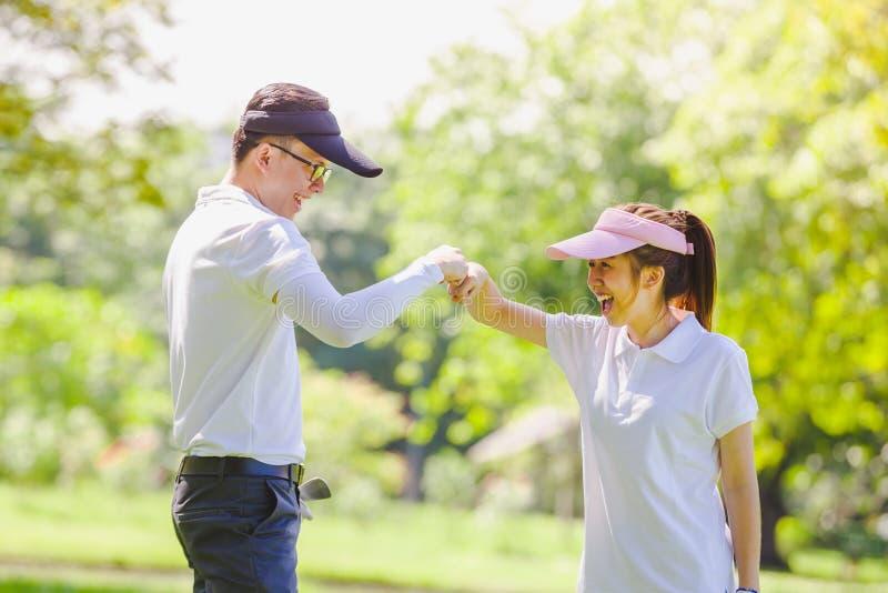Couples de golf photos stock