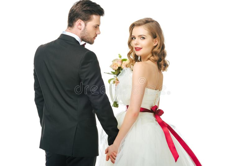Couples de mariage jugeant des mains d'isolement sur le blanc photo libre de droits