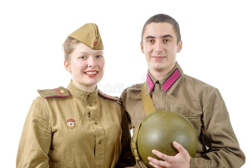Couples de portrait dans l'uniforme militaire russe photo stock