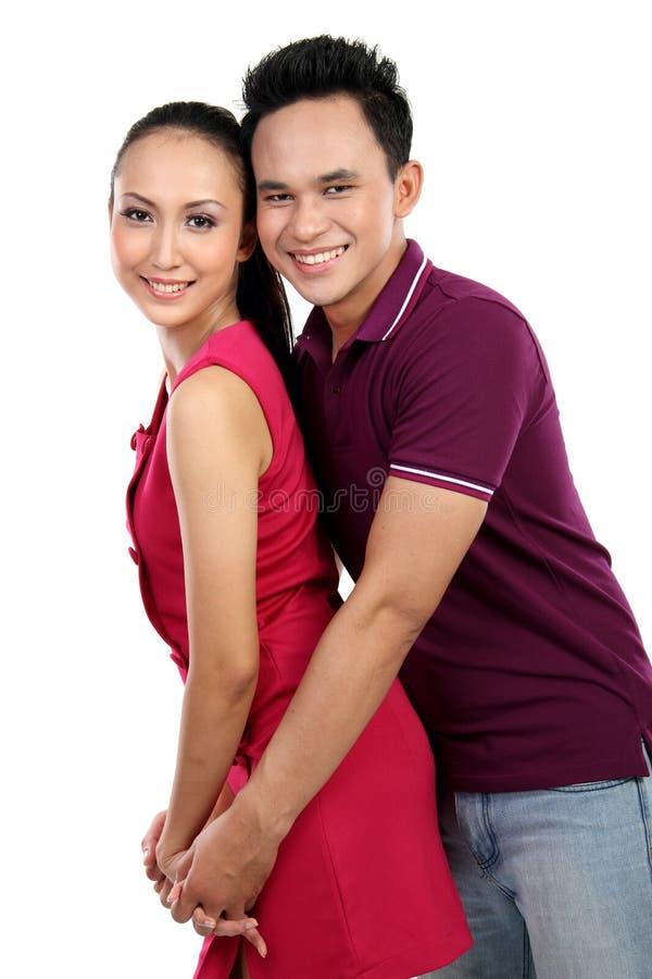 Couples de sourire heureux d'isolement sur le blanc photos stock