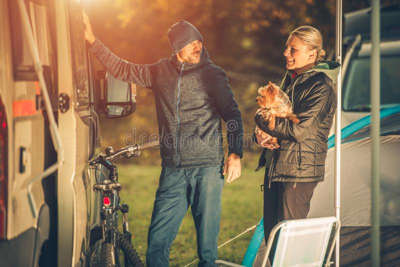 Couples with Dog Camping. Young Caucasian Couples with Dog Motorhome RV Camping. Campground Fun royalty free stock images