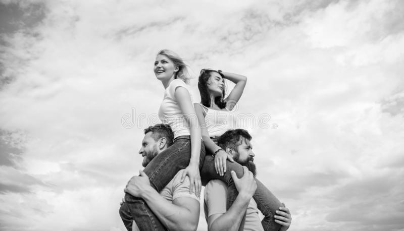 Couples on double date. Inviting another couple to join. Twice fun on double date. Friendship of families. Couples in. Love having fun. Men carry girlfriends on stock image