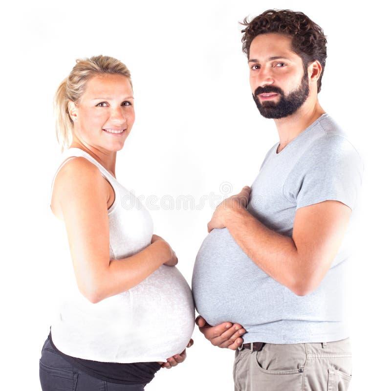 Couples enceintes de jeunes images libres de droits