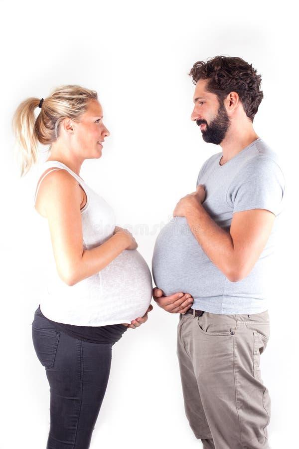 Couples enceintes de jeunes photographie stock