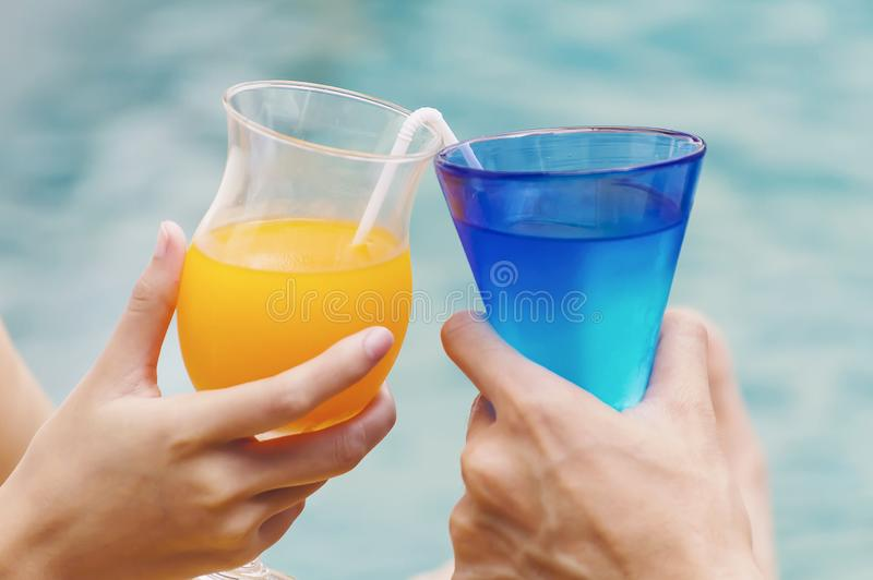 Couples enjoy with cocktail party. In the swimming pool stock photos