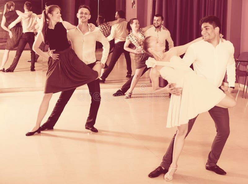 Couples enjoying latin dances royalty free stock images
